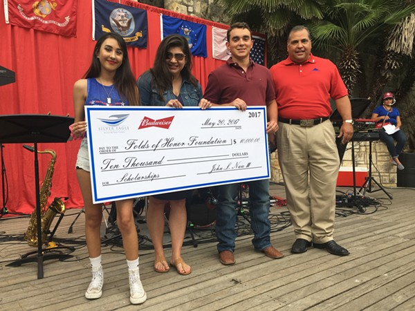 Raquel Castro (left) and Marcus Greydanus (second from right) each receive $5,000 awards - COURTESY OF SILVER EAGLE DISTRIBUTOR