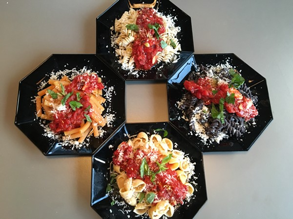 Counter-clockwise from top: Quinoa and rice fusilli, black bean rotini, Banza shells and red lentil sedanini. - RON BECHTOL