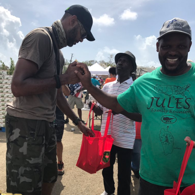 """Classic @DuncanRelief — thanking and serving at the same time.  So many were given food, hope, and a smile today."" - PHOTO VIA TWITTER, MIGUERRASAFB"
