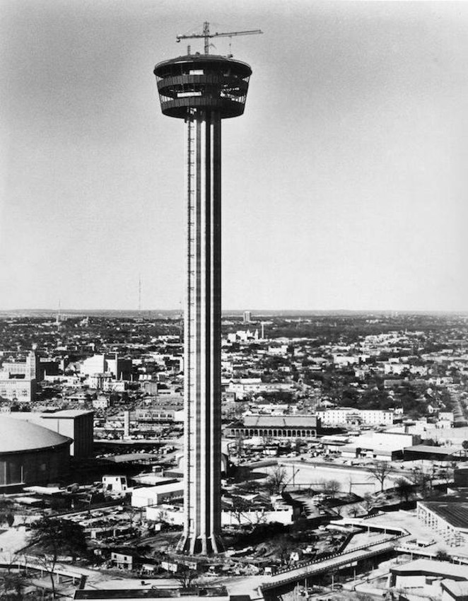 "1967, Tower of the America's, HemisFair '68. After the main shaft of the tower was completed they started on the ""top house"" that would contain the Tower Restaurant and the observation deck."