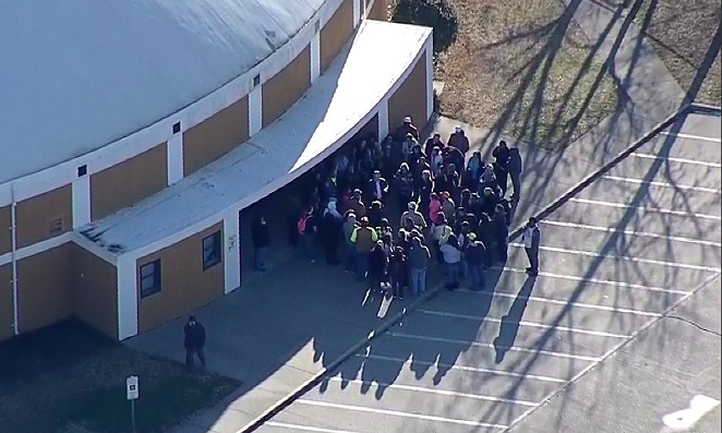 Parents gather outside of an Italy High School building Monday morning. - TWITTER / @GRLOPEZ4