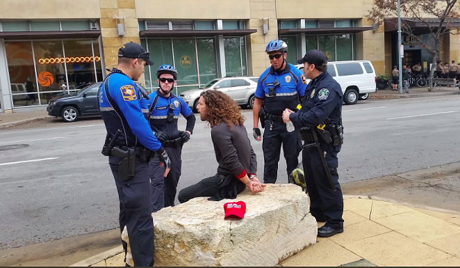 Wood, feat. Austin police shortly after the hat-napping - SCREENSHOT VIA TWITTER USER @ARGUELLODOTJPG