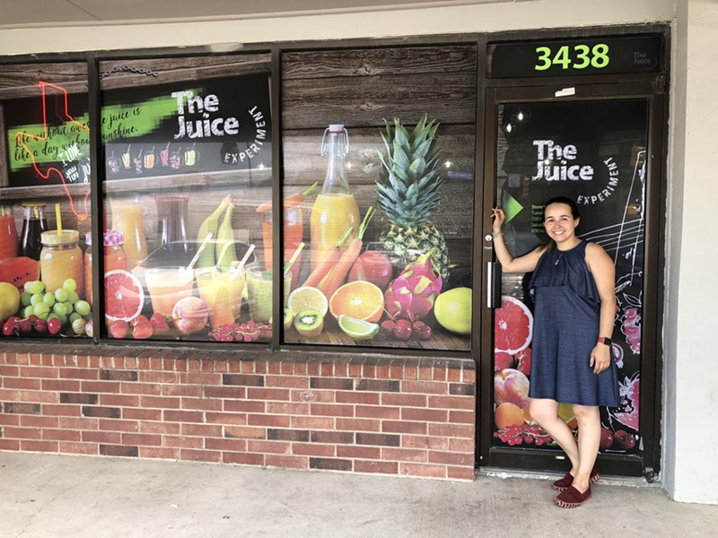 Aguirre in front of The Juice Experiment which opens this August. - JESS ELIZARRARAS