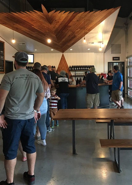 Tasting room at Family Business Brewery - RON BECHTOL