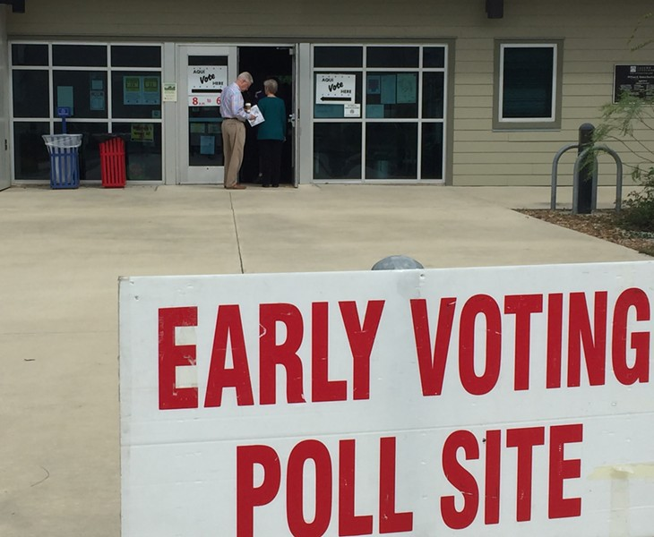 Early voters line up at a San Antonio polling site. - SANFORD NOWLIN