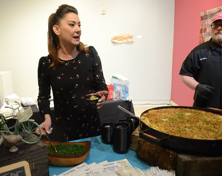 Jenn White of Eastside Kitchenette serves up bacon mac and cheese at the Women Shaking It Up event. - LEA THOMPSON