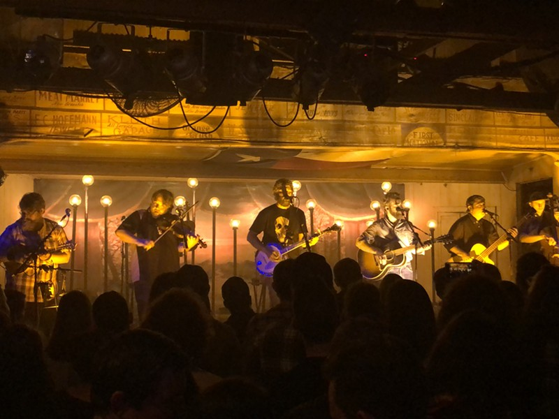 Trampled by Turtles getting down at Gruene Hall. - CHRIS CONDE