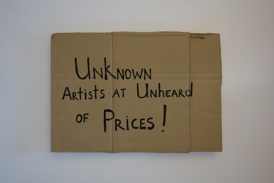 Diaz lampoons the art world in his sculptures that resemble signs that homeless people often carry. He began his art career in New York by selling these to tourists at Tiffany's.