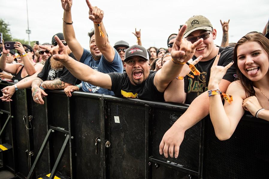 Fans at the barricade go crazy at a recent River City Rockfest. - JAIME MONZON