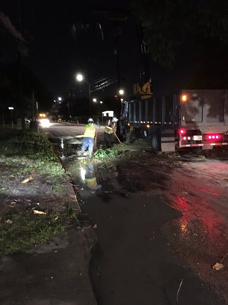 A cleanup crew removes debris from a roadway following Thursday's thunderstorm. - TWITTER / @MAXMASSEYTV