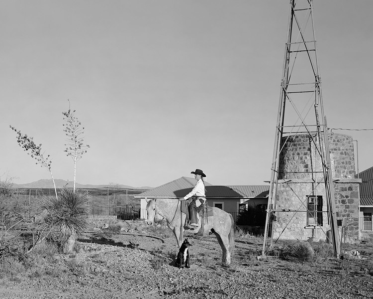 """This photo is titled """"Evan Hall mounted on favorite horse 8-Ball."""" This is one of a series of photographs depicting modern cowboys at the SaddleUp exhibit. - JOE VITONE PHOTOGRAPHY"""