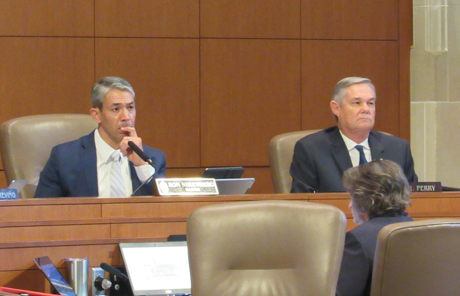 Mayor Ron Nirenberg (left) and Councilman Clayton Perry listen to a speaker at Thursday's meeting. Nirenberg championed the Climate Action & Adaption Plan, while Perry cast the sole vote against it. - RHYMA CASTILLO