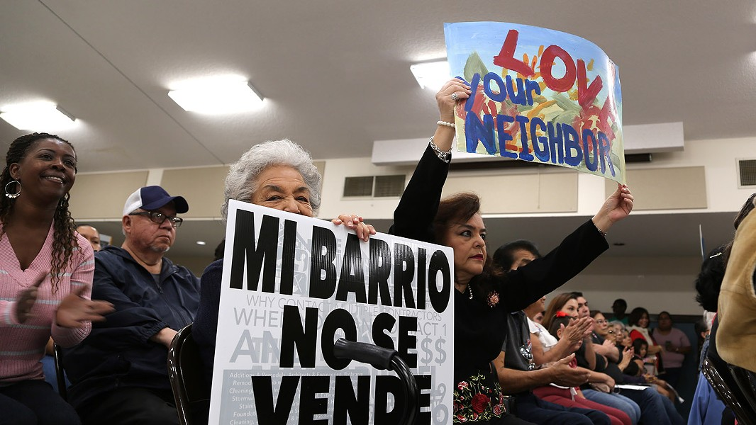 Elisa Diaz (center) and Bertie Diaz-Gonzales attend a City Council candidate forum hosted by COPS Metro Alliance in April at St. Patrick's Catholic Church, where gentrification and affordable housing was the hot topic. - BEN OLIVO / SAN ANTONIO HERON