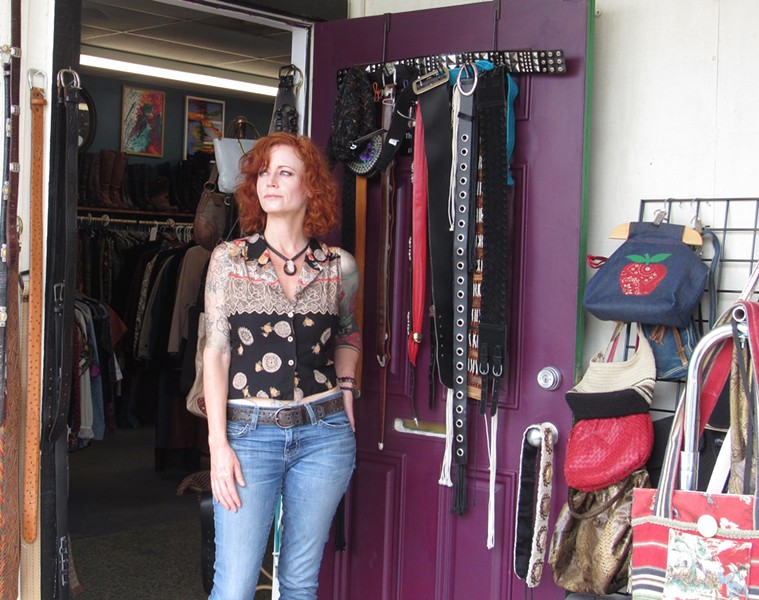 Tabitha Garcia-Rogers looks out the door of her vintage clothing shop, Thrash Weave. Even before city council voted to close most businesses for 30 days, she'd seen virtually no customer traffic. - SANFORD NOWLIN