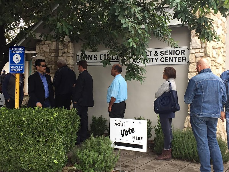 Voters waited in line to cast their ballots at Lion's Field in San Antonio during the 2018 midterms. Democrats argue that people should be allowed to avoid crowded polling places during the pandemic. - SANFORD NOWLIN