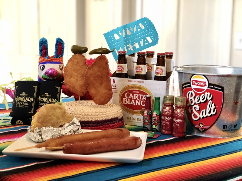 The NIGHT IN OLD SQZBOX party packs include Fiesta favorites such as chicken on a stick, gorditas, footlong sausages and footlong corndogs. - COURTESY PHOTO / SQUEEZEBOX