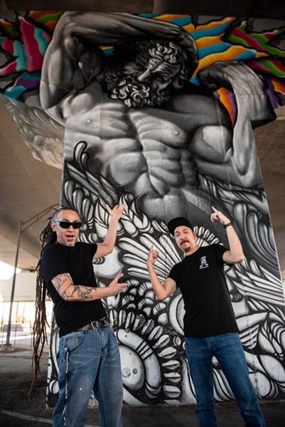 "Nik Soupè and David ""Shek"" Vega show off their work under Interstate 35, just north of downtown San Antonio. - JAIME MONZON"