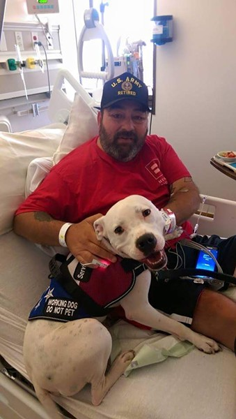 Here's Edwin Patterson recovering with his service dog, Langton, after doctors amputated one of his legs. - TEAM PLUTO