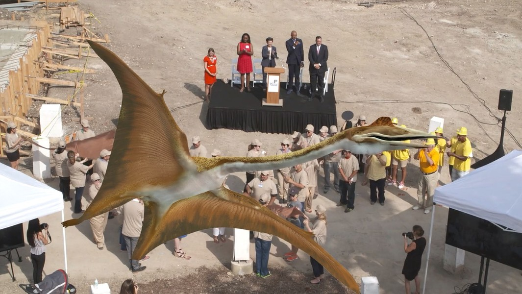 "A planned ""flash mob"" formed a scale replica of ""Quetzy,"" a Quetzacoatlus northropi — the largest known flying animal — at a press conference Tuesday where the Witte Museum unveiled plans for its new entrance, which will feature the dinosaur. - SCREEGRAB"