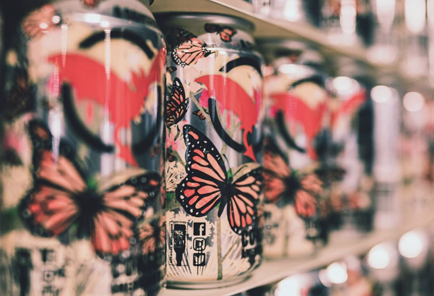 Freetail's Conserveza Blonde Ale can design features native Texan butterflies — another benefactor of Conserveza proceeds. - INSTAGRAM /  ANDO_KUROHIGE