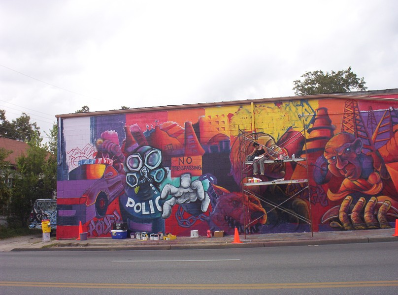 "Muralist Ruth Buentello works on ""Piedad"" in 2003. - COURTESTY"
