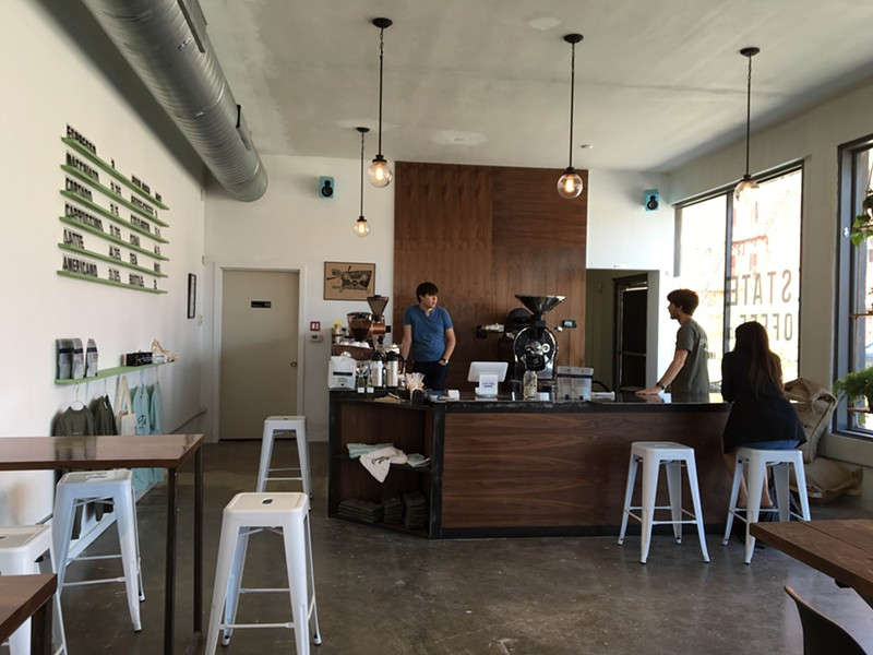 Estate Coffee Company owner Brian Labarbera and barista and roaster Alex Dyck work behind the counter. - JESSICA ELIZARRARAS | SAN ANTONIO CURRENT