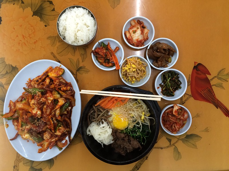 Clockwise from L-R: Charbroiled squid, rice, assorted banchan, stone pot bibimbap