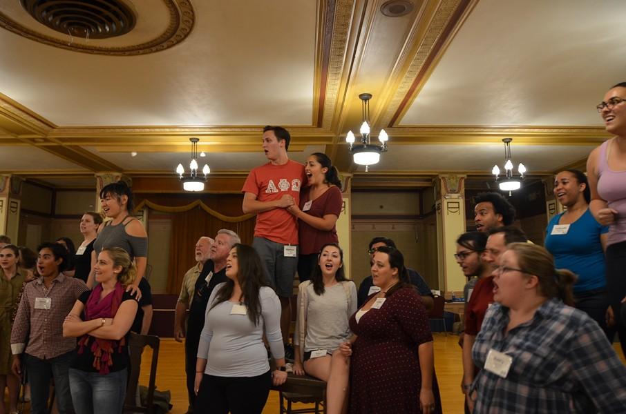 Chorus members performing the Act II finale