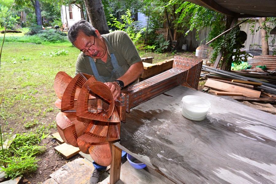 "Gregorio ""Goyo"" Rebollar at work on a torchiere"