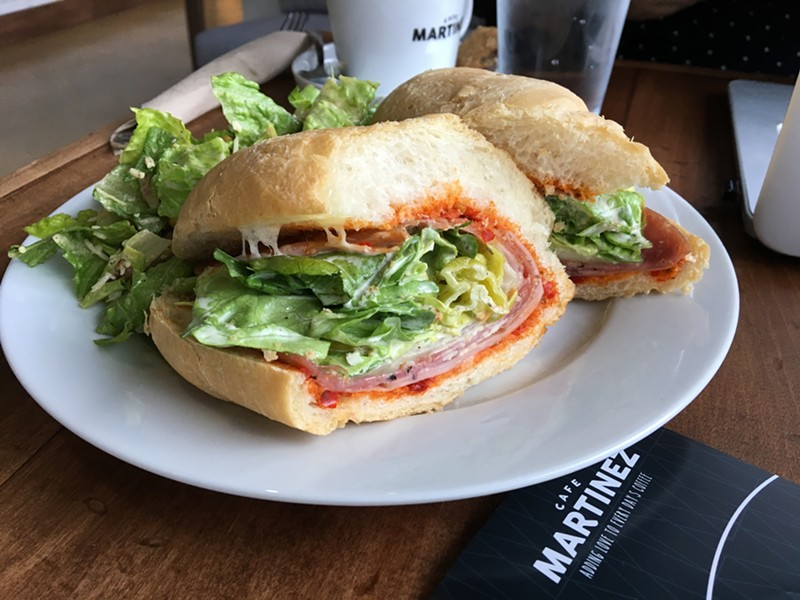The Grand Tano with mortadella, salami cotto, soppressata, provolone, garlic mayo, pepperoncini in a hoagie roll. - JESSICA ELIZARRARAS