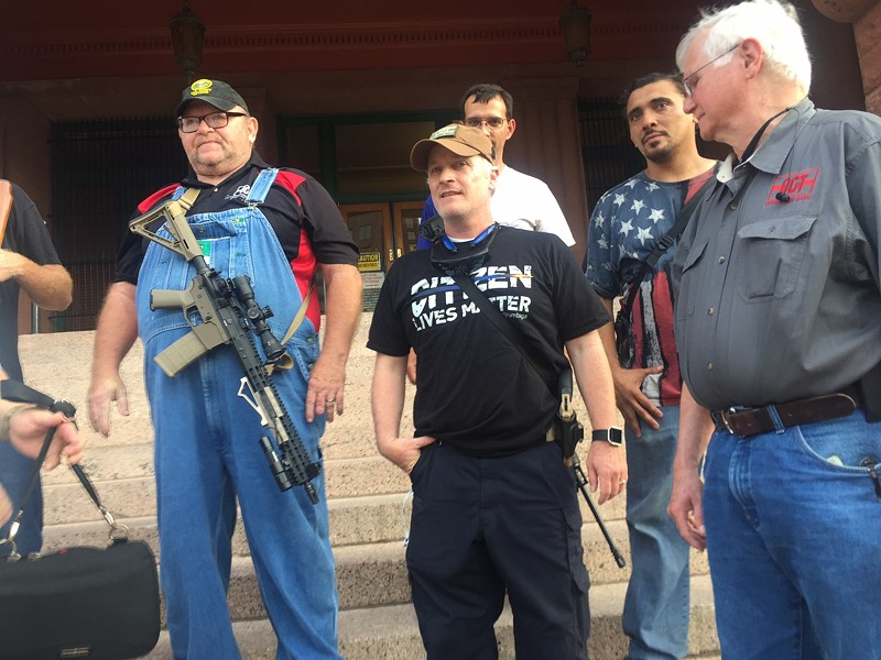 CJ Grisham (center), president of Open Carry Texas, says McDonnell should be commended, not prosecuted. - MICHAEL BARAJAS