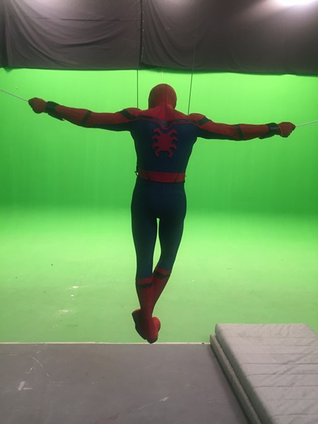 Chris Silcox in full Spider-Man outfit doing stunts on a green screen. - CHRIS SILCOX
