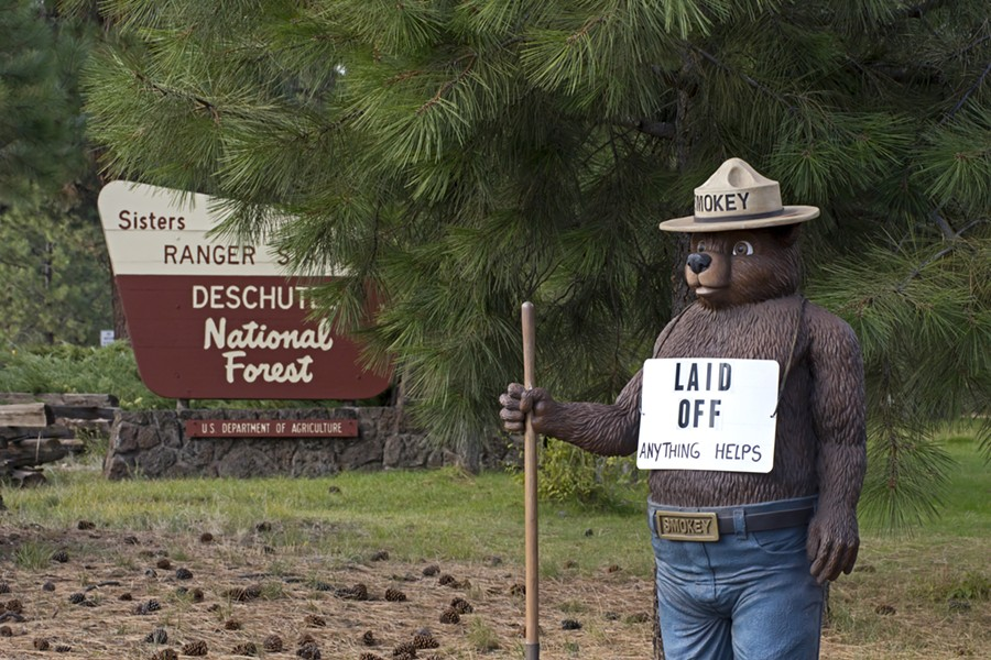 "Smokey the Bear with a ""Laid Off"" sign during the 2013 government shutdown. - SHUTTERSTOCK"
