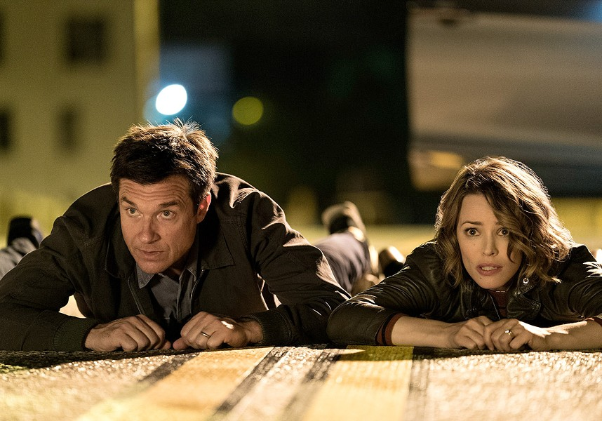 Married couple Annie and Max (Rachel McAdams and Jason Bateman) get in over their heads during the R-rated comedy Game Night. - WARNER BROS.