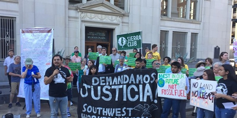 Climate activists, including members of the Sierra Club, rally in front of City Hall in 2019.