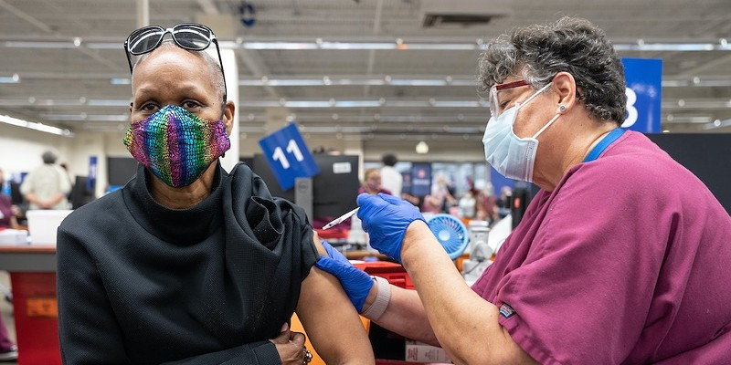 A San Antonio resident gets her jab at a mass vaccination site earlier this year.