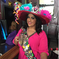 20 People Totally Slaying the Fiesta Medal Game Hat? Check. Pretty dress? Check. A sash covered in badass medals? Super check.     Photo via amandalynnmi