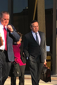 Attorney Michael McCrum and Carlos Uresti exit U.S. federal courthouse.