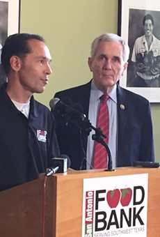 The S.A. Food Bank's Eric Cooper (left) and Rep. Lloyd Doggett discuss the farm bill's proposed cuts to food assistance.