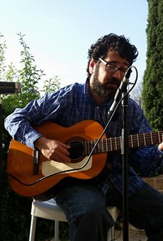 Singer-songwriter Jason Christopher Trevino performs an outdoor gig in San Antonio.