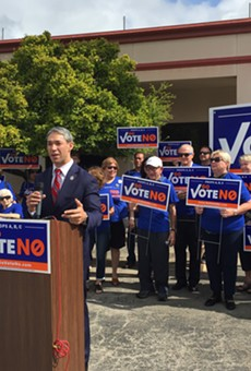 Mayor Ron Nirenberg speaks at the Go Vote No presser, surrounded by local Democrats.