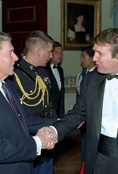 """Self-made man"" Donald Trump meets President Ronald Reagan in this photo of a 1987 White House reception."