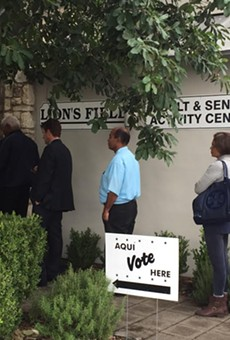 Early voters wait in line to cast their ballots at Lion's Field.
