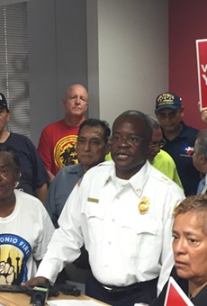 Fire union officials speak at a press conference during the runup to the charter amendment vote.