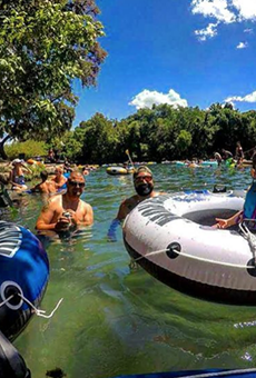 Tubers enjoy sun and suds on New Braunfels' Comal River.