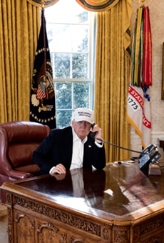 "Donald Trump is shown ""working"" as hard as a furloughed employee in this White House publicity photo."