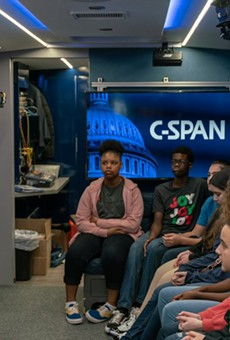A Harris County precinct commissioner visits with students on the C-Span bus.
