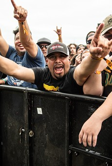 Fans at the barricade go crazy at a recent River City Rockfest.