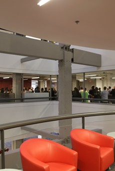 Employees meet inside Rackspace's corporate headquarters.