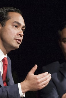 Julian Castro (foreground) makes a point while his brother Joaquin looks on.